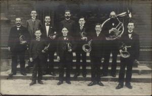 Music Men & Boys w/ Brass Instruments Tuba Trumpets etc RPPC c1910