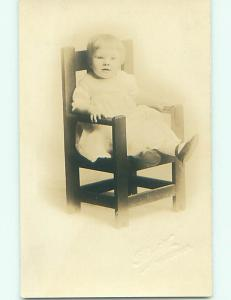 Pre-1930 rppc CHILD IN ANTIQUE WOODEN CHAIR AT STUDIO Worcester MA r6990