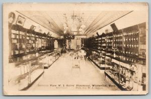 Whiteville Tennessee~WI Gates Pharmacy Interior~Display Cases~Bottles~1913 RPPC