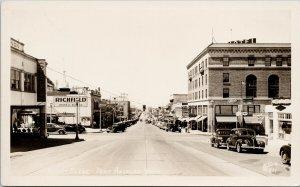 Port Angeles WA Elks Club Lee Hotel Derby Cafe Ellis #4211 RPPC Postcard G38