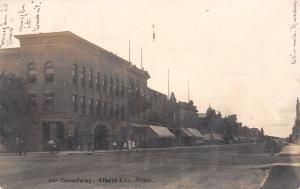 Albert Lea~Dr Stevenson Office~2nd Floor~News Store Bldg~Dirt Broadway RPPC 1907