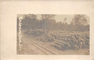 Brienon France c1910 RPPC Real Photo Postcard Stacked Timber Railroad Tracks