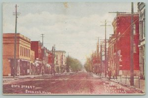 Fremont Nebraska~Dirt 6th Street Lined With Telephone Poles~c1910 PC