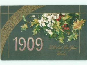 Unused 1909 new year NUMBERS SHOWN BESIDE FLOWERS AND HOLLY k4990