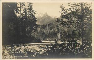 Canada Capilano River and Lions real photo postcard 1927 by Leonard Frank