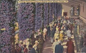 Cashing winning tickets at Hialeah Park, Miami, Florida,  PU_1940