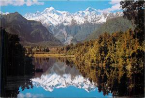 New Zealand Mt. Tasman and Mount Cook from lake Matheson butterfly stamp
