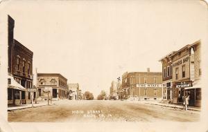F35/ Rolfe Iowa RPPC Postcard 1914 Main Street Harness Shop Bank