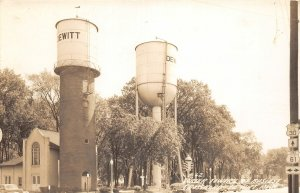 G83/ DeWitt Iowa RPPC Postcard c1940s Water Towers Busy Corner