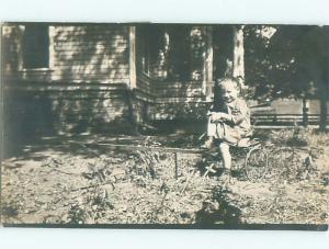 rppc Pre-1918 CHILD SITTING ON ANTIQUE REVERSE TRICYCLE STROLLER SEAT AC7717