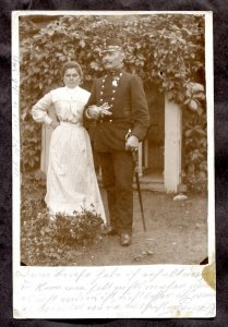 dc112 - AUSTRIA 1902 Decorated Officer with Wife. Sword. Real Photo Postcard