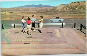 Four women at Four Corners Monument Arizona Utah Colorado New Mexico