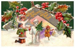 Christmas Children building Snowman