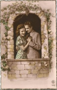 Romantic French Couple posing in Garden Wall with Ivy and Roses