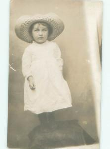 rppc Pre-1920's CHILD WEARING STRAW HAT STARES INTO CAMERA AC7934