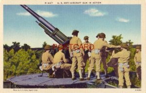 U.S. ANTI-AIRCRAFT GUN IN ACTION photo by US Signal Corps