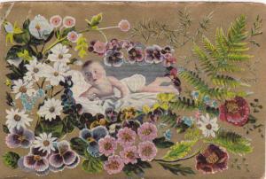 Baby lying among flowers, 10-20s