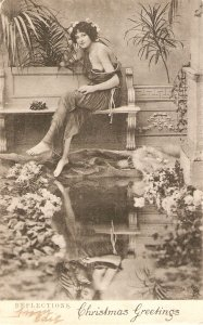 Lady sitting in bench. Reflections Tuck Art Series Postard # 1068