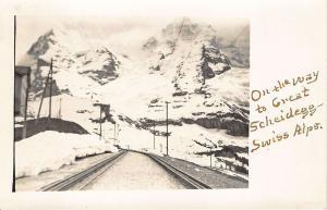 Switzerland In The Swiss Alps Railroad Tracks Great Scheidegg RPPC Postcard