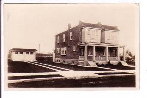 Real Photo, Brick Duplex with Garage.  1910-1930