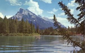 Canoe on Bow River near Mt Rundle AB, Alberta, Canada