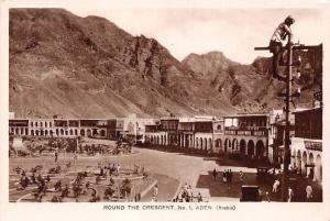 Yemen Aden Round the Crescent No. 1 old cars, man climb electric power tower