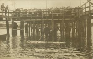 Farewell at the Pier to Traveler on strange Vessel (1910s) RPPC Postcard