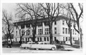 Primghar Iowa automobiles Court House1950s RPPC Photo Postcard 21-6011