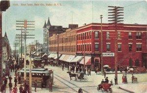F79/ Boise City Idaho Postcard c1910 Street Scene Trolley Stores Crowd