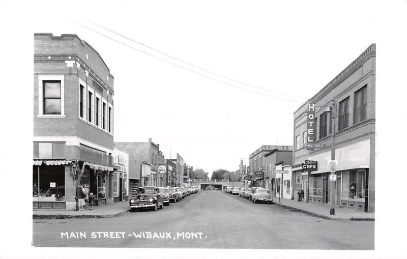 Wibaux Montana~Main Street~Palace Cafe~Bar~Jim's Barber Shop~1950 Cars~RPPC