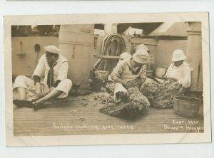 REAL PHOTO POSTCARD~ US NAVY ~ SAILORS MAKING FOOT MATS ~  Copyr 1910