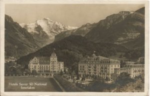 Mountain Scene in Switzerland showing 2 hotels Savory & National Interlaken
