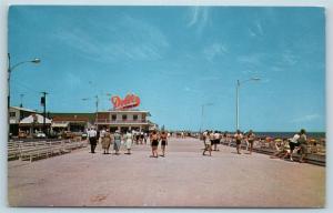 Postcard DE Rehoboth Beach North View on Boardwalk Dolle's Salt Water Taffy N1