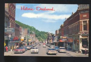 DEADWOOD SOUTH DAKOTA 1950's CARS DOWNTOWN STREET SCENE VINTAGE POSTCARD