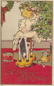 CHRISTMAS , 1911 ; Child on a rocking horse