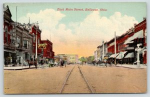 Bellevue Ohio~East Main Street~Wolf's Clothing Store~Cook's Lightbulb Sign~c1910