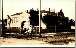 1910s RPPC Real Photo Postcard Children & School Building View - Marked Iowa