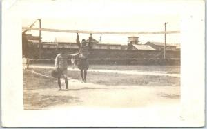 1910s WWI RPPC Real Photo Postcard Army Base Scene Calvary Uniforms Workout Yard