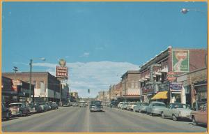 Kalispell, Mont., Main Street Looking North-1950 street scene, Coke, Conrad Bank