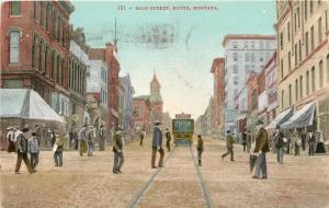 Butte Montana~Main Street~Men Cross in Front of Trolley~Stores~Business~1908 PC