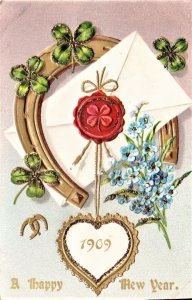 Vintage New Year Card. 1909 embossed with shamrocks for  a lucky year