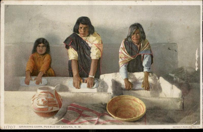 grinding corn Pueblo de Laguna New Mexico native typical costumes