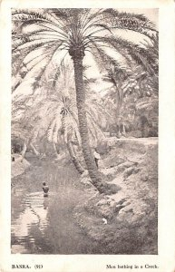 Men bathing in a Creek Basra Iraq Unused