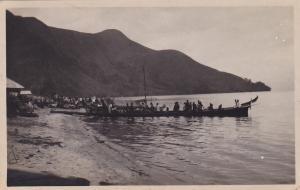 RP: Natives boarding canoe , Java , Indonesia , 00-10s