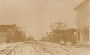 G24/ Plainview Iowa RPPC Postcard c1910 Stores Homes Snow