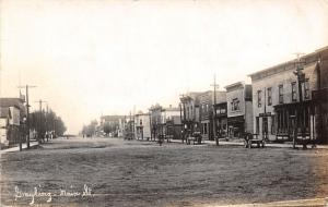Grayling Michigan~Main Street~Cigar Store~Hotel~Wagons~Wide Dirt Road~1914 RPPC