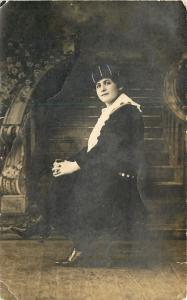 Lady Sitting at the Bottom of Ornate Staircase~Striped Hat~Real Photo Postcard
