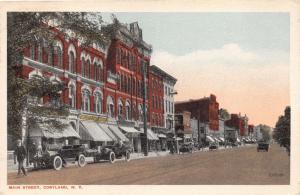 CORTLAND NEW YORK MAIN STREET~OLD CARS~WOLCOTTS CASH MARKET POSTCARD 1918