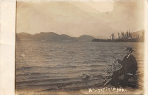 F50/ Whitefish Lake Montana RPPC Postcard 1913 Man on Shore