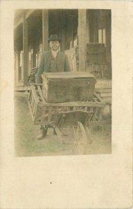 C-1910 Elkton Kentucky RPPC Photo Postcard Man Pushing Wheel Barrow Cart 20-872
